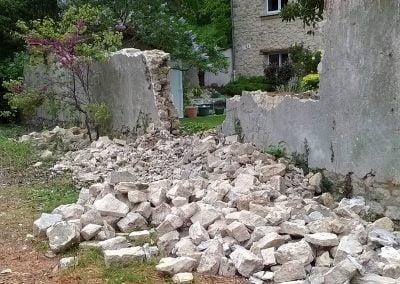 Démolition du mur en pierre