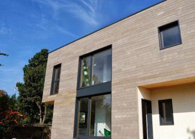 Maison en bois sur struction en béton