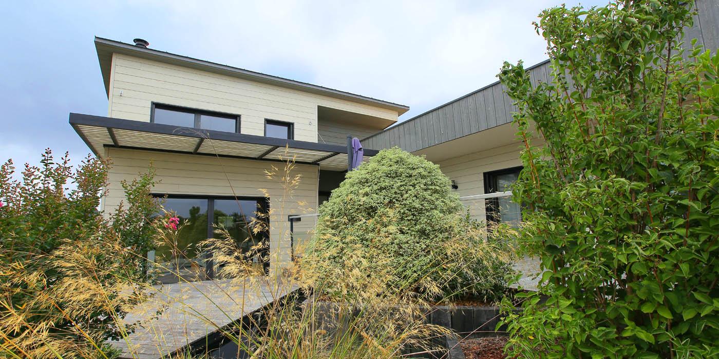 Maison en ossature bois de 280 m2 en bardage bois douglas